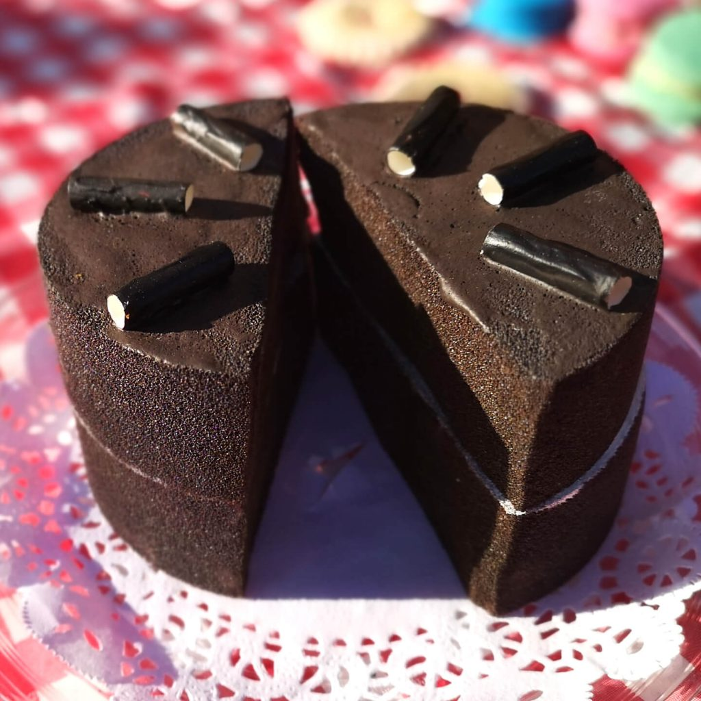 Play food chocolate cake sitting in the sun.