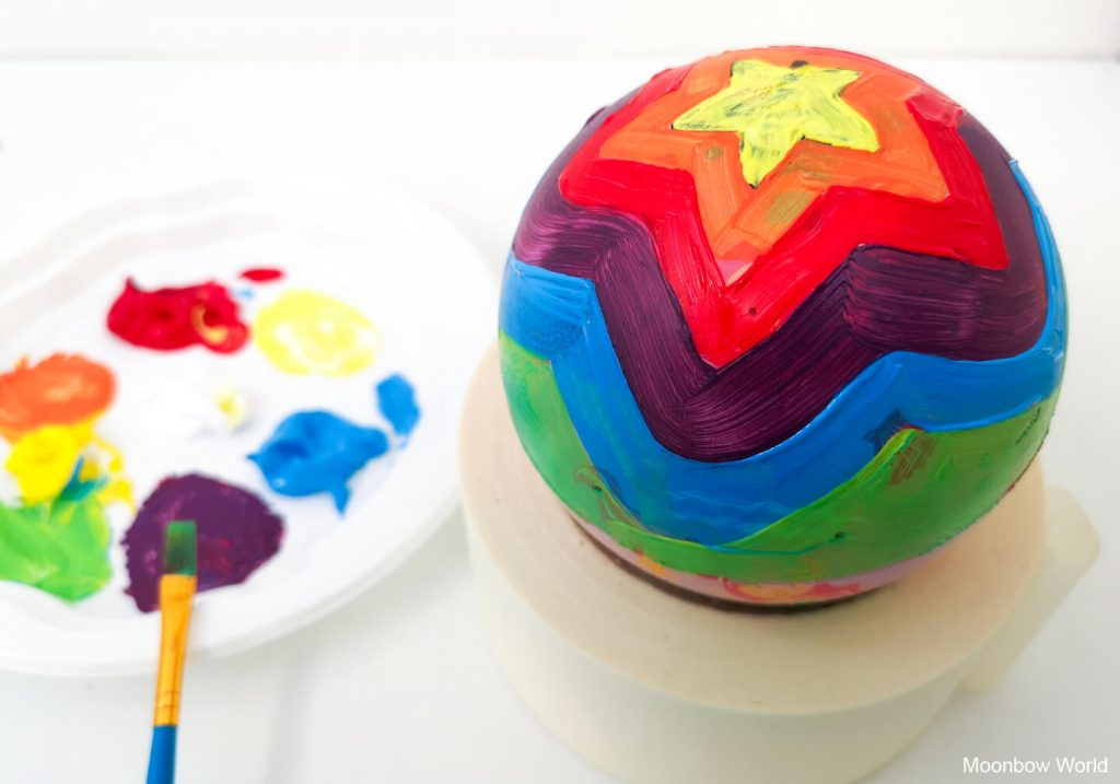 Decorate the ball with acrylic paint.